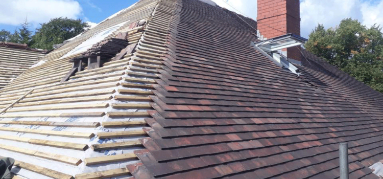 Restored pitched roof in Hale using existing and reclaimed tile